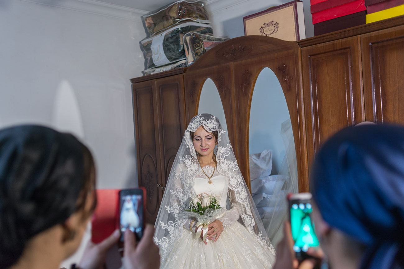 Traditional Chechen wedding starts with a feast in the house of the bride.