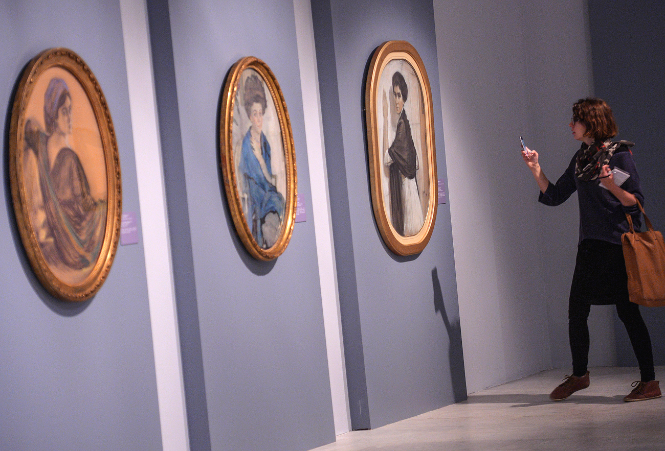 Photo: A visitor observes the paintings 'Portrait of Henrietta Girshman' (1911), 'Portrait of Yelena Oliv' (1909) and 'Portrait of Sofia Olsufyeva' (1911) at the 'Valentin Serov. Towards 150th birth anniversary' exhibition in the State Tretyakov Gallery on Krymsky Val in Moscow.