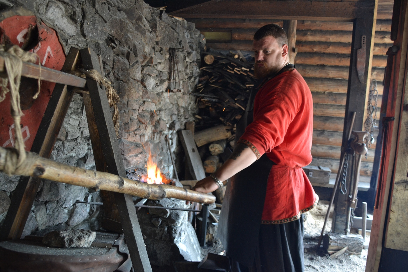 "Voldemar: ""Does anybody want to have a fight with our smith? No-one? You are right not to."" Photo: A man works in a smithy."