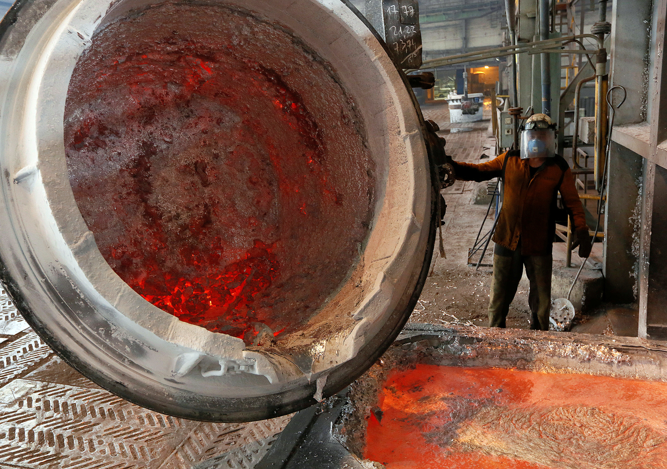 A worker operates a mixer of fused aluminium at the foundry shop of the Rusal Krasnoyarsk aluminium smelter in Krasnoyarsk, Siberia