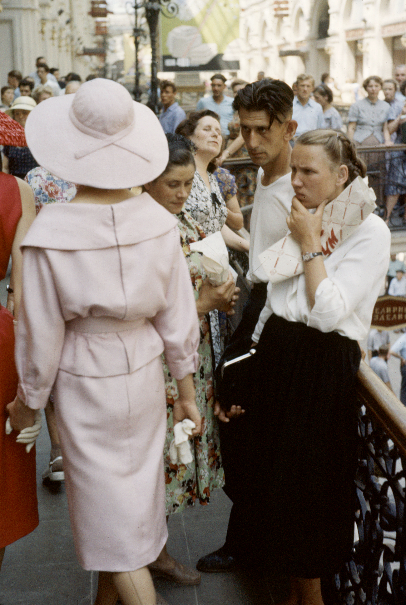 RUSSIA - CIRCA 1959: Dior models in Soviet Union for officially sanctioned fashion show attracting crowd of curious Russians.
