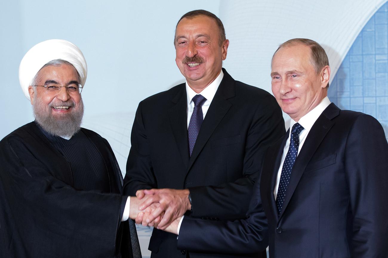 Iranian President Hassan Rouhani, left, Azerbaijan's President Ilham Aliyev, center, and Russian President Vladimir Putin pose for a photo during their meeting in Baku, Azerbaijan, Monday, Aug. 8, 2016.