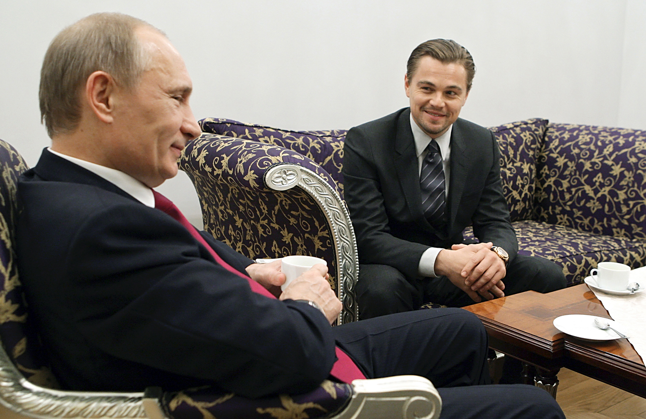 Russia's Vladimir Putin (L) in his capacity as prime minister listens to actor Leonardo DiCaprio during their meeting in St. Petersburg on Nov. 23, 2010.