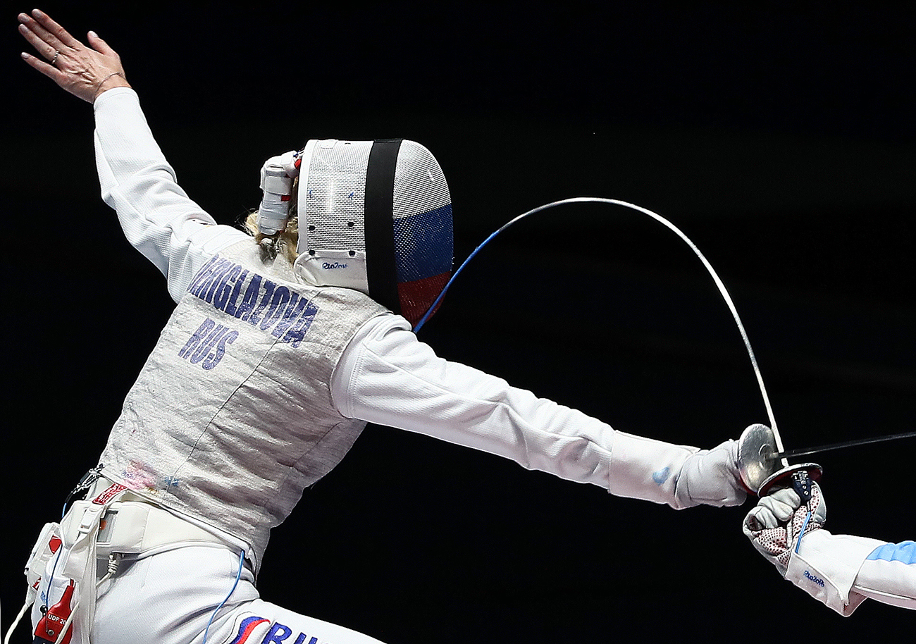 Inna Deriglazova of Russia in action against Elisa di Francisca of Italy during a gold medal bout in the women's individual foil at the Rio 2016 Olympic Games in Rio de Janeiro, Brazil. Inna Deriglazova won the bout, earning the 4th gold for the Russian Olympic Team.