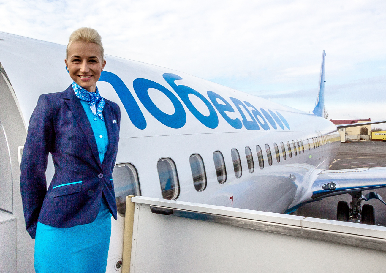 A stewardess of a Pobeda (Victory) Airline's plane poses at a city airport in Volgograd, Russia. Pobeda is a subsidiary of Aeroflot-Russian Airlines.