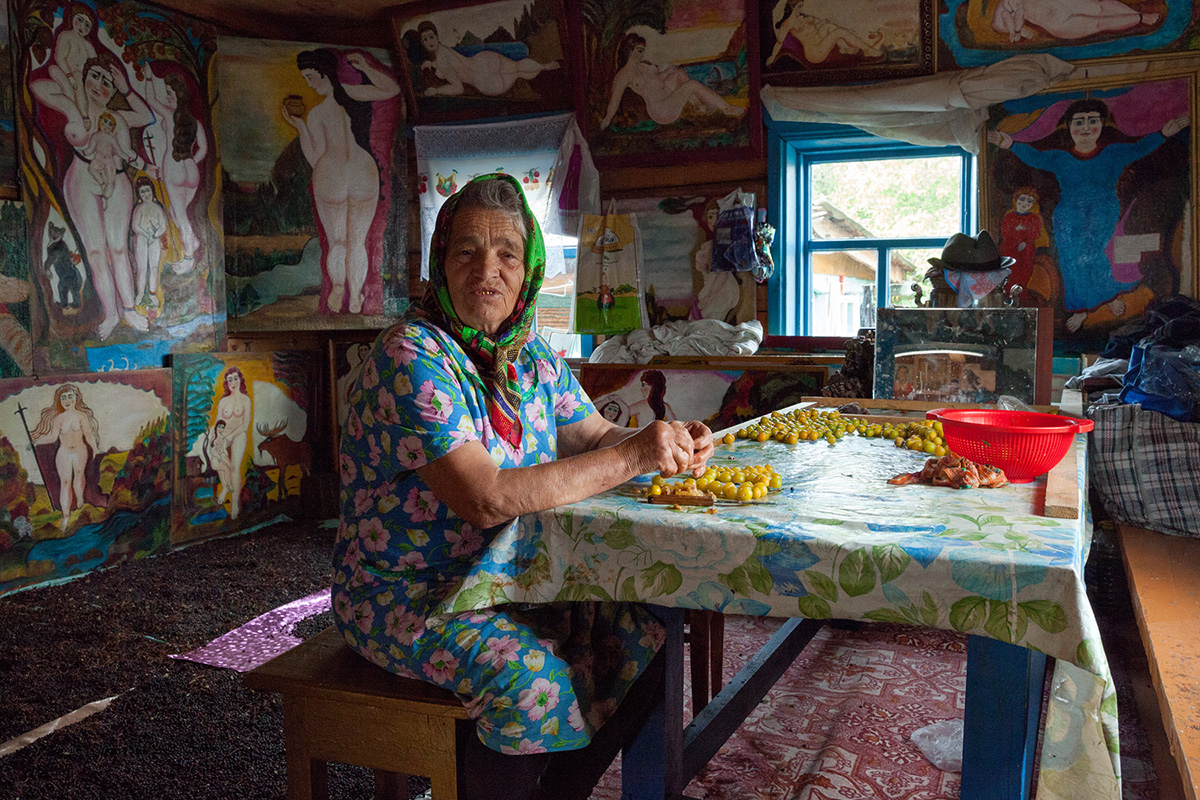 Bichura village, Buryat Republic. Local inhabitant Polikarp Sudomoikin became famous 10 years ago. After retirement, he started painting and making icons. His main muse is his wife (pictured).