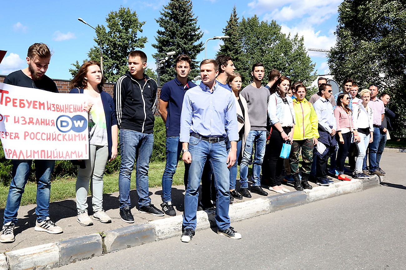 Protesters picket in front of the German Embassy in Moscow on Aug. 16 demanding a cartoon posted on Deutsche Welle's website lampooning Russian Paralympians be taken down.