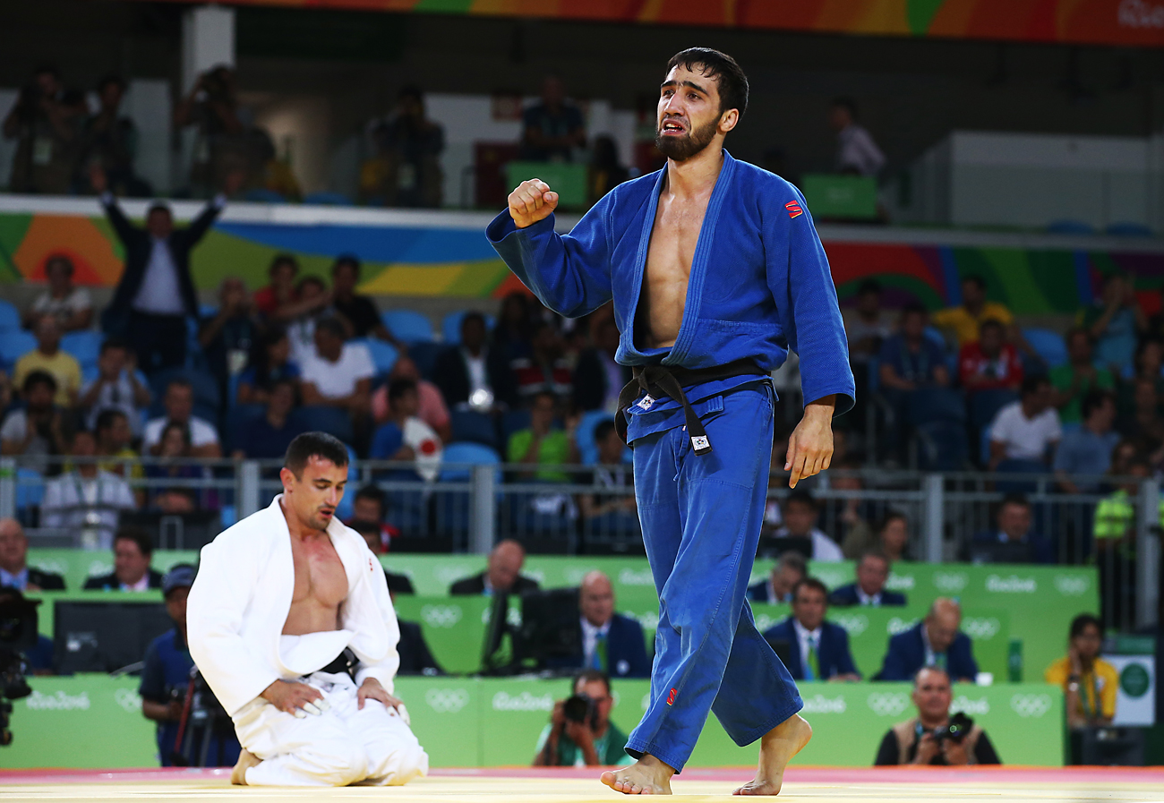 RIO DE JANEIRO, BRAZIL - AUGUST 9, 2016: Judokas Sergiu Toma (L) of the United Arab Emirates and Khasan Khalmurzayev of Russia seen during their men's -81kg judo semifinal at the Rio 2016 Summer Olympic Games, at Carioca Arena 2.