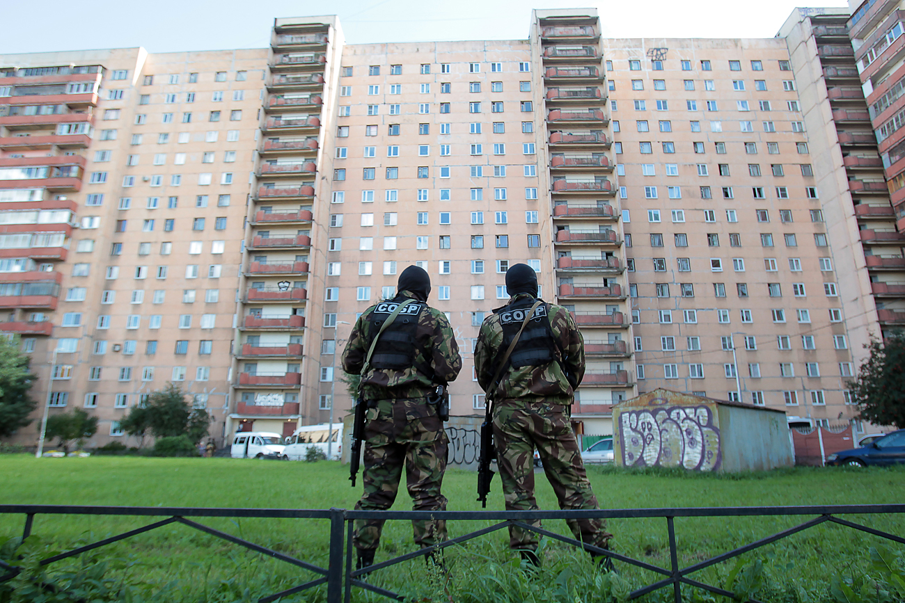 Members of the Special Rapid Response Unit (SOBR) seen outside a residential house in Leninsky Avenue during a counterterrorism operation conducted by the Russian Federal Security Service (FSB), Aug. 17.