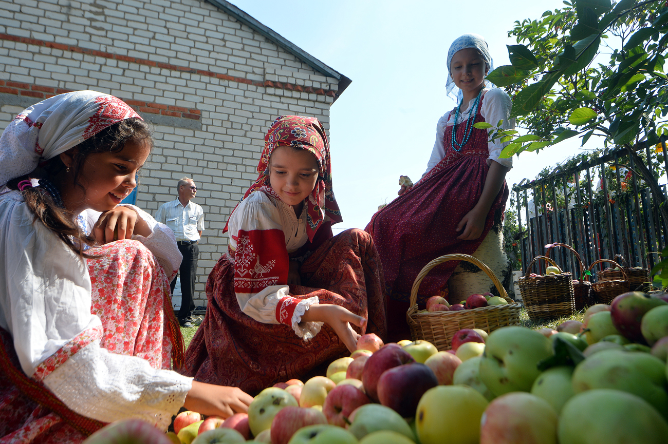 Young girls attend the feast of the Transfiguration of the Savior at Gorky Museum in the village of Krasnovidovo in the Kamsko-Ustyinsky district of Tatarstan