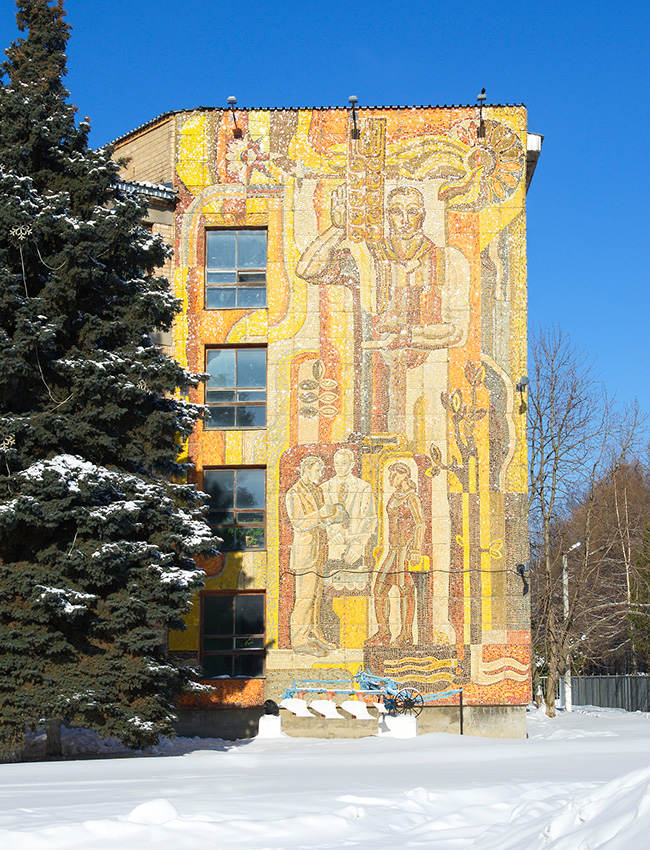 Some mosaics glorify Soviet workers, scientists, miners, steelworkers, milkmaids, and (later) cosmonauts. / Mosaic on the wall of an agricultural college in the village of Novosin'kovo.