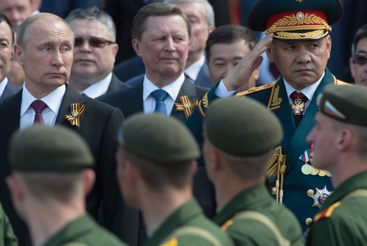 Pictured L-R: Vladimir Putin, Sergei Ivanov, Sergei Shoigu during the Victory Day celebrations in 2016.