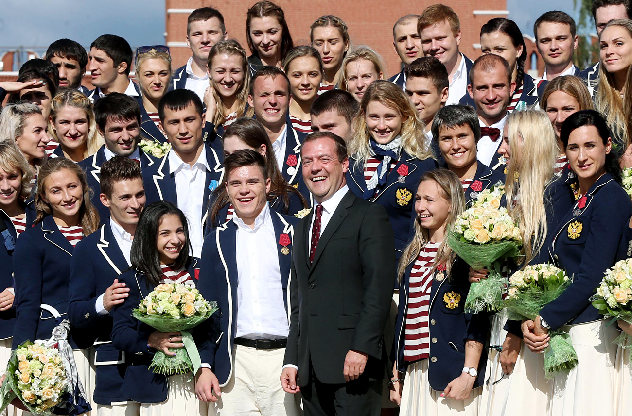 MOSCOW, RUSSIA - AUGUST 25, 2016: Russia's Prime Minister Dmitry Medvedev (C front) at a ceremony to present BMW cars to Russian athletes, medalists of the 2016 Summer Olympic Games held in Rio de Janeiro, Brazil.