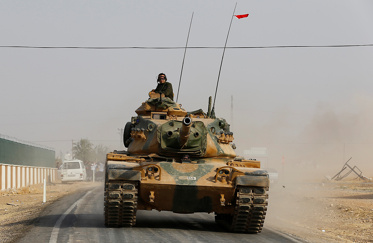 A Turkish army tank drives towards to the border in Karkamis on the Turkish-Syrian border in the southeastern Gaziantep province, Turkey, Aug. 25, 2016.