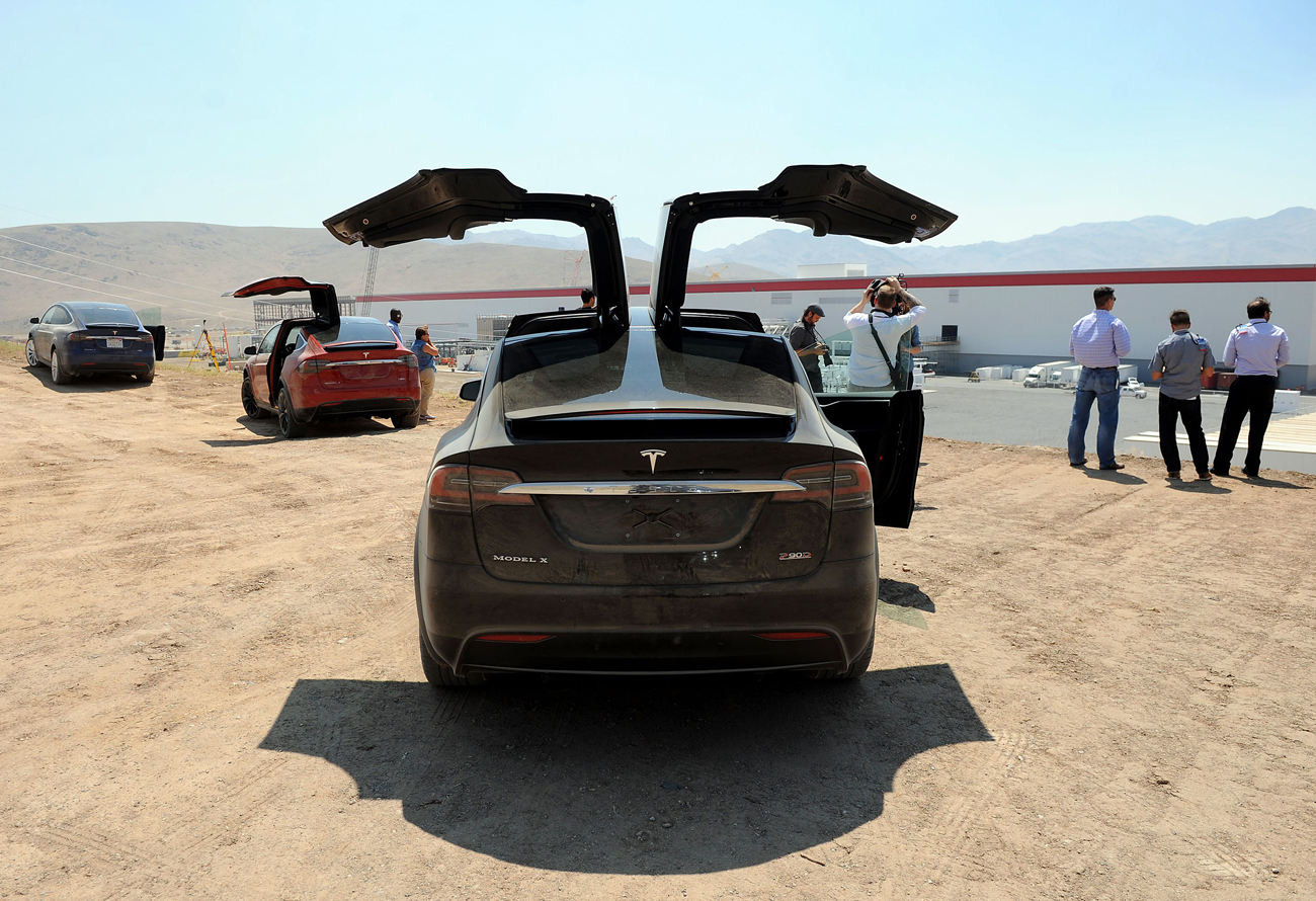 Members of the media tour the Tesla Gigafactory which will produce batteries for the electric carmaker in Sparks, Nevada, U.S.