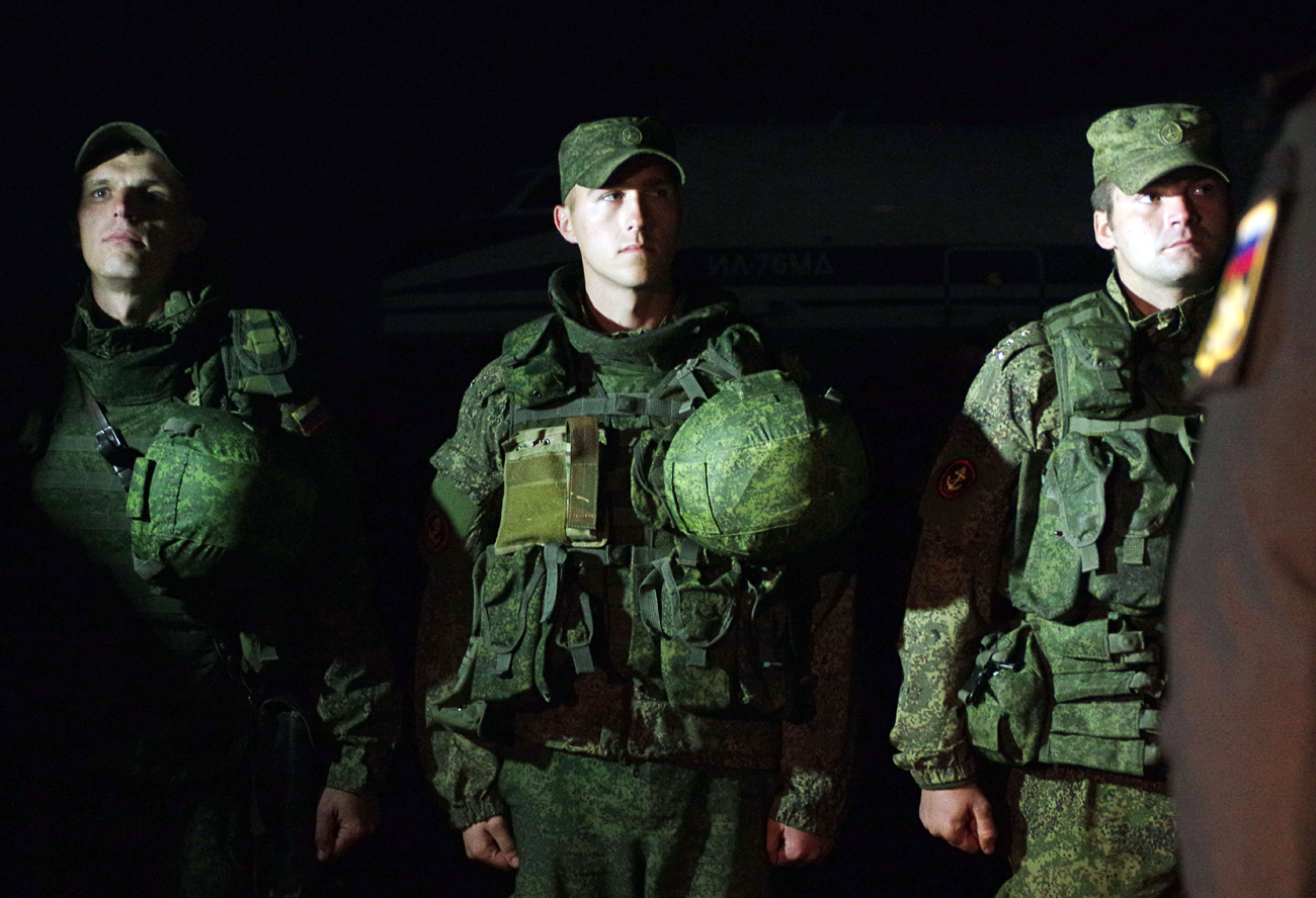 Russia's Black Sea Fleet marines who arrived after a successful operation guarding the Hmeymim airbase in Syria, on the Belbek airfield near Sevastopol. Cropped image.