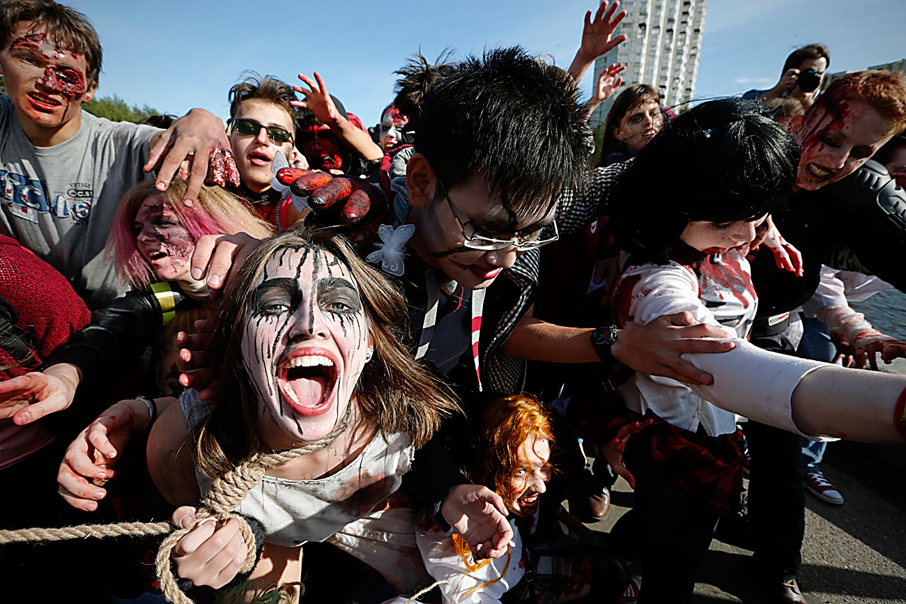 People costumed as ghouls and zombies gather at a Zombie flash mob in central St.Petersburg, Russia, 28 August 2016. The Zombie flash mob refers to the worldwide annual events of the 'Zombie Walk' where people dress up as zombies. The Zombie Walk was originated in the USA and took place for the first time in Sacramento in 2001