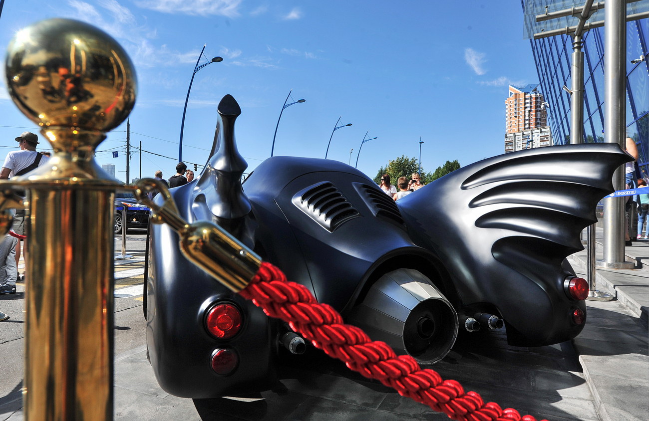 A copy of the Batmobile featured in Tim Burton's Batman films on display by the Rio shopping mall in Leninsky Prospekt Street