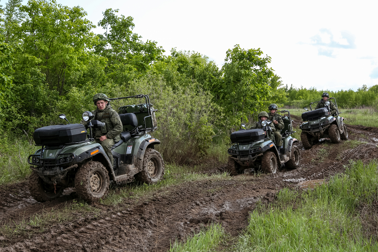 Cadets of the Marshal Rokossovsky Far Eastern Higher Military Command School drive ATVs RM 500-2 during training exercises at the fire range in the Blagoveshchensk District in the Amur Region, Russia.