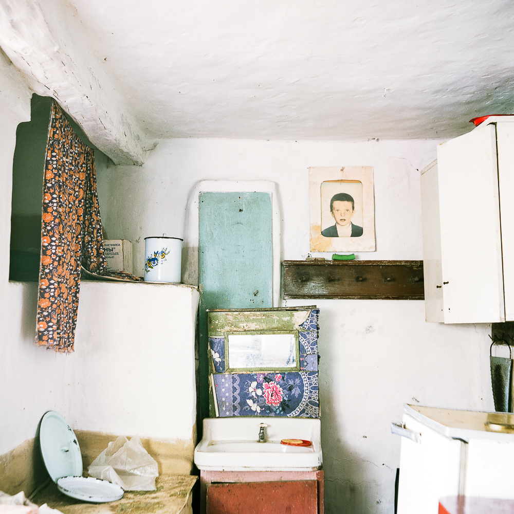 The authentic interiors in the photos impart a sense of unreality.