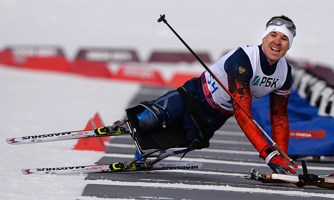 Alexei Bychenok at the shooting lane of the short distance race in the men's LW 10-12 (sitting) class biathlon at the Sochi 2014 Winter Paralympics.
