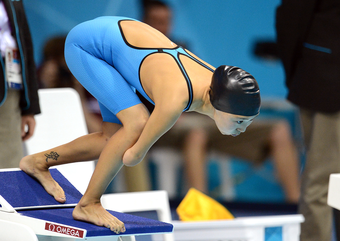 Anastasiya Diodorova competes in the women's 50m butterfly S6 final at the 14th Summer Paralympics in London.