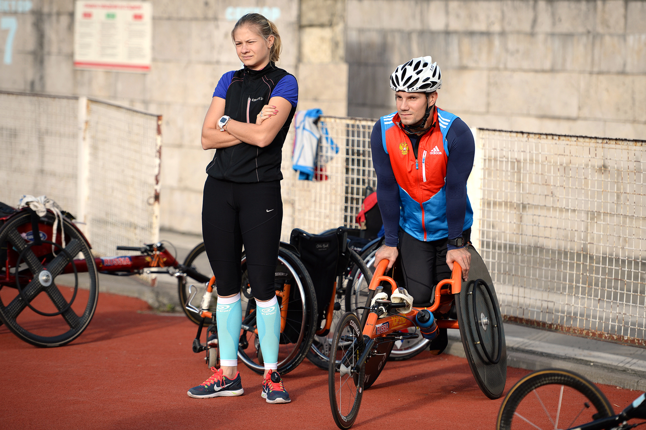 Athletes Ivan Goncharov and Margarita Goncharova during a training session of the Paralympic biathlon and cross-country skiing national team.
