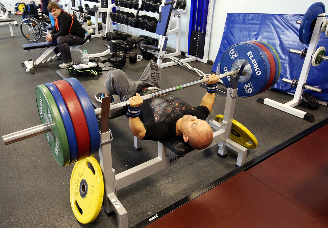 Powerlifing silver medallist of the 2012 Paralympic Games Vladimir Balynets during a training session by the Russian Paralympic powerlifting team at the Oka training center.