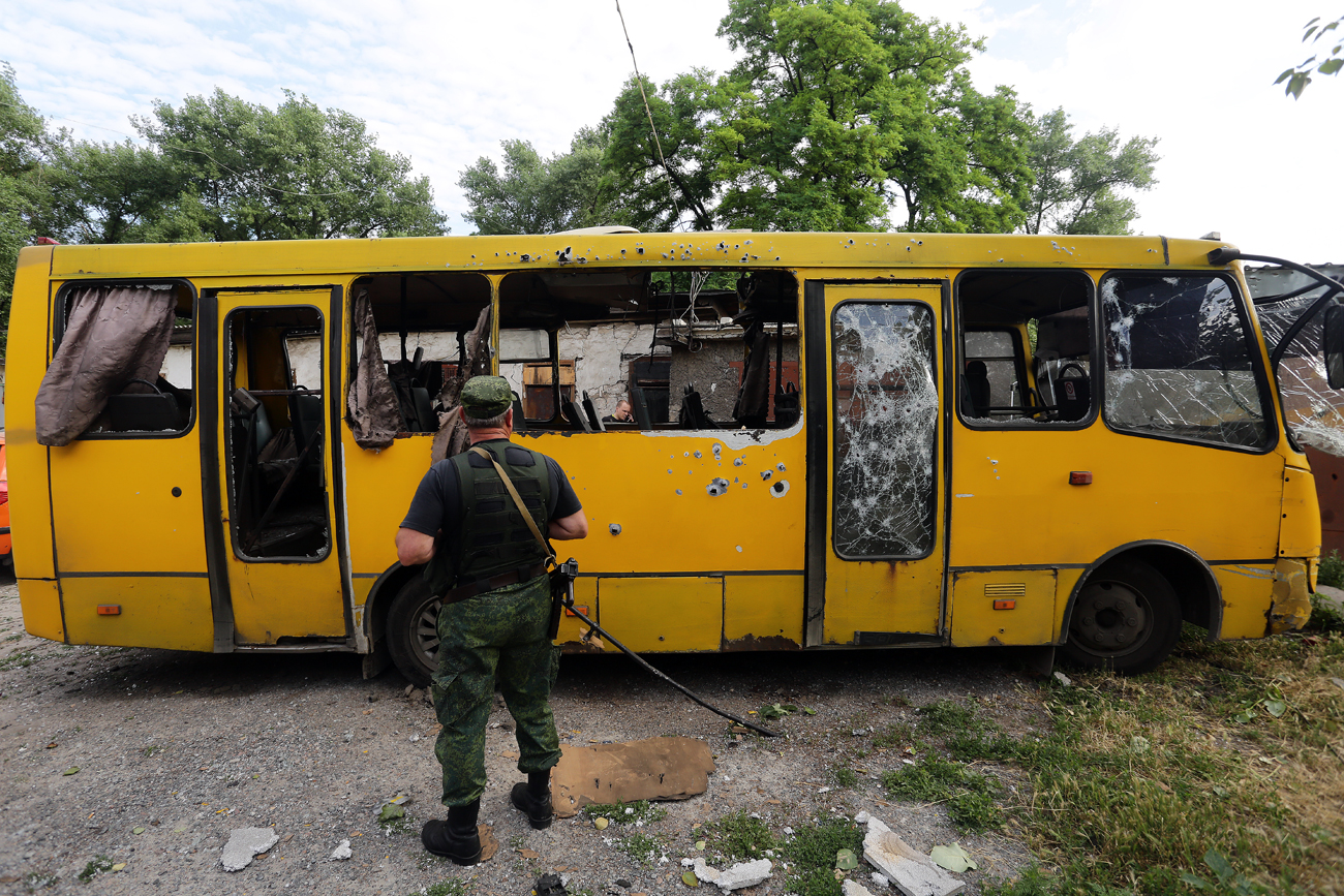 A bus riddled with bullets in the Kuibyshevsky District