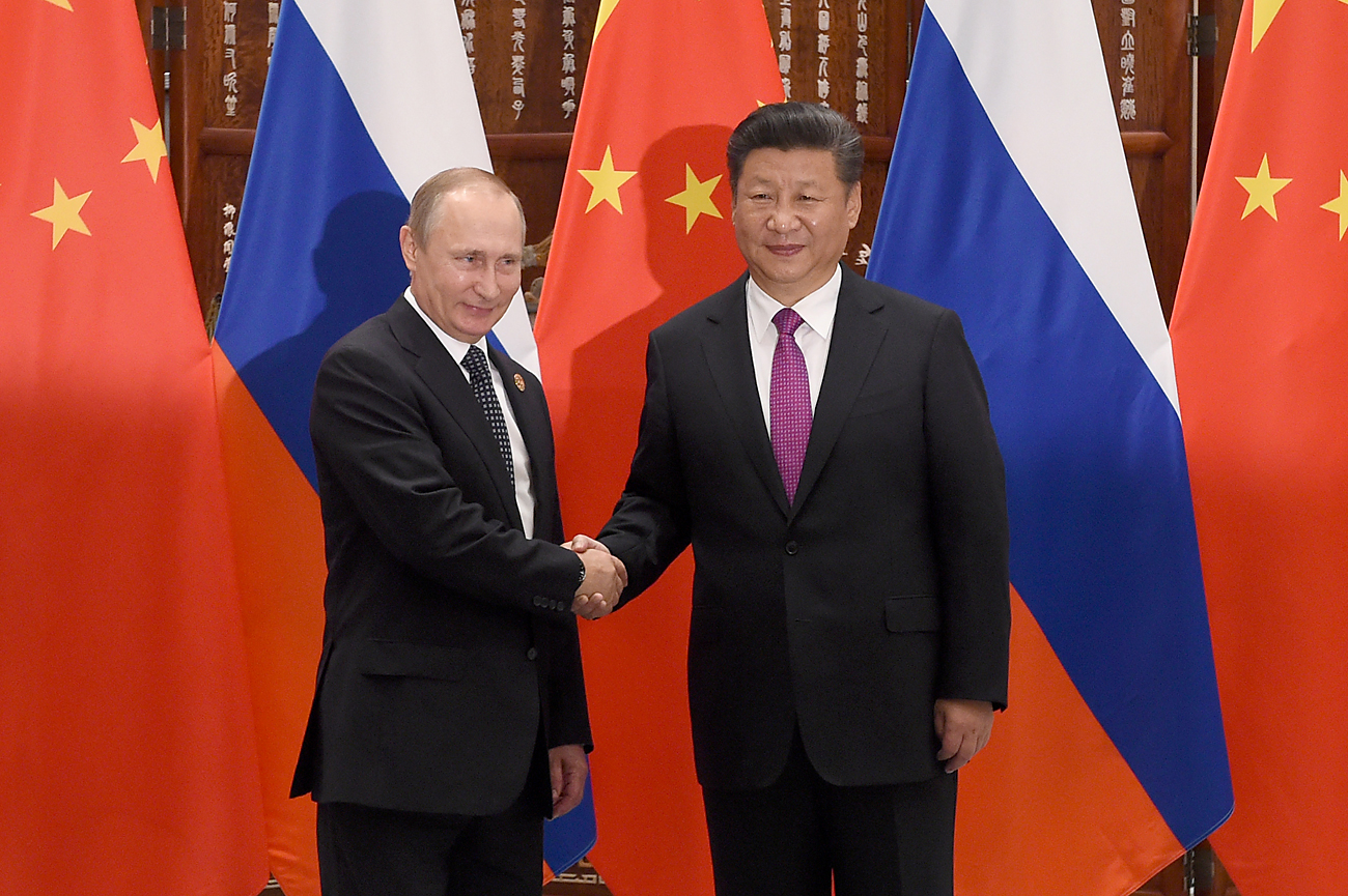 Chinese President Xi Jinping shakes hands with Russian President Vladimir Putin ahead of G20 Summit in Hangzhou, China, in September 2016.