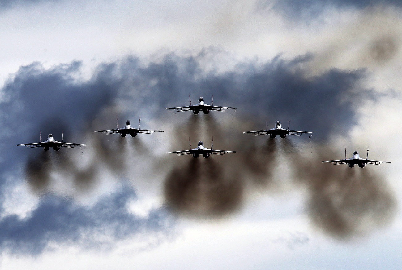 Mikoyan MiG-29 jet fighter aircraft of the Strizhi [Swifts] aerobatic team perform during an air show as part of the Army-2016 international military-technical forum at the Patriot Congress and Exhibition Centre in the town of Kubinka