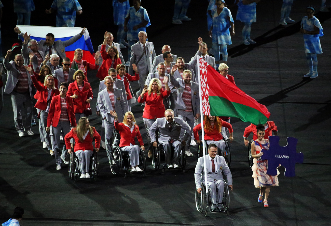 During the parade of nations at the Maracana stadium on Sept. 7, a member of the Belarusian team's delegation carried the flag of Russia along with their national flag.