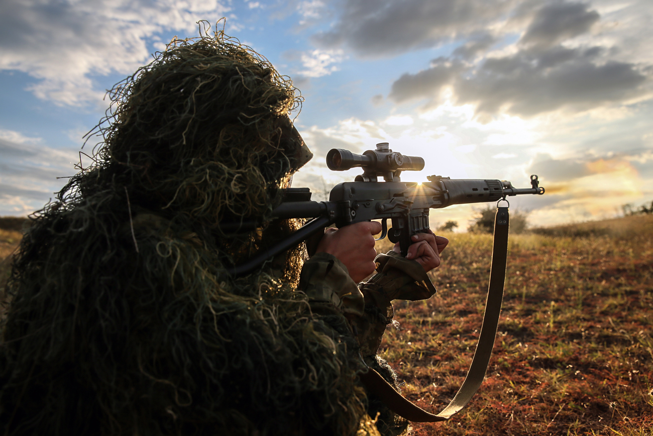 STAVROPOL TERRITORY, RUSSIA - SEPTEMBER 7, 2016: A sniper seen during tactical exercises held by motorized infantry units of Russia's Southern Military District as part of the Caucasus 2016 strategic drills, at Sernovodsky range.