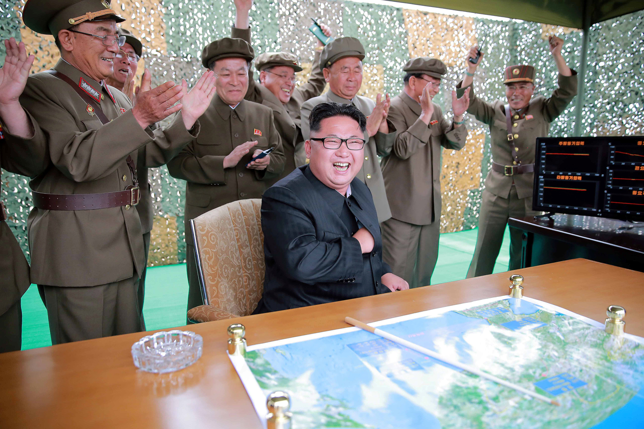 North Korean leader Kim Jong Un reacts during a test launch of ground-to-ground medium long-range ballistic rocket Hwasong-10 in this undated photo released by North Korea's Korean Central News Agency (KCNA).