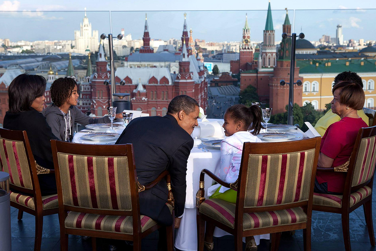 In the 2000s, many events were held here. Muscovites and visitors alike were treated to military parades on Red Square, flower carpets covering its timeworn pavers, as well as football, racing, skating, and rally competitions. / U.S. President Barack Obama dining with his family on the roof of the Ritz Carlton Hotel with view of Red Square and the Historical Museum. July 7, 2009.