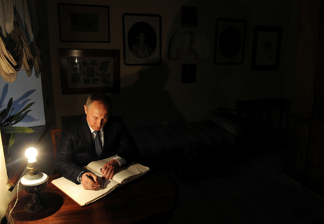 Russian President Vladimir Putin signs a visitors' book at the Yasnaya Polyana estate museum, home of Leo Tolstoy, where the legendary Russian writer worked on War and Peace and Anna Karenina. Yasnaya Polyana is located outside the city of Tula, Russia.
