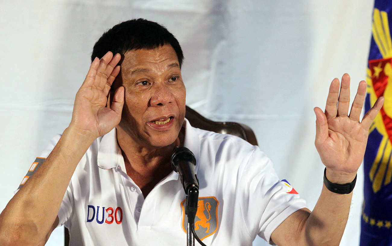Philippine President Rodrigo Duterte speaks during a news conference in Davao city, southern Philippines.
