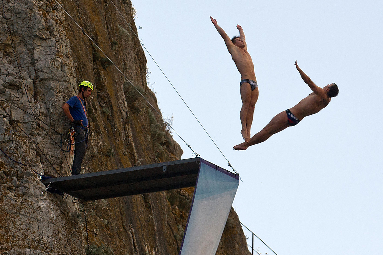 Athletes at the high diving training base on Diva cliff in Simeiz, Crimea.