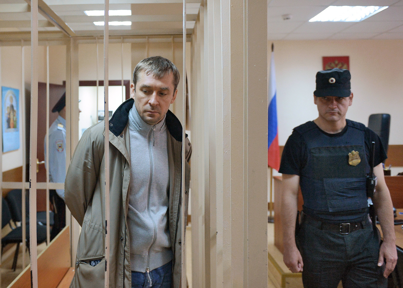 Russian anti-corruption official Dmitry Zakharchenko is charged with official misconduct, obstructing justice and large-scale bribery.
