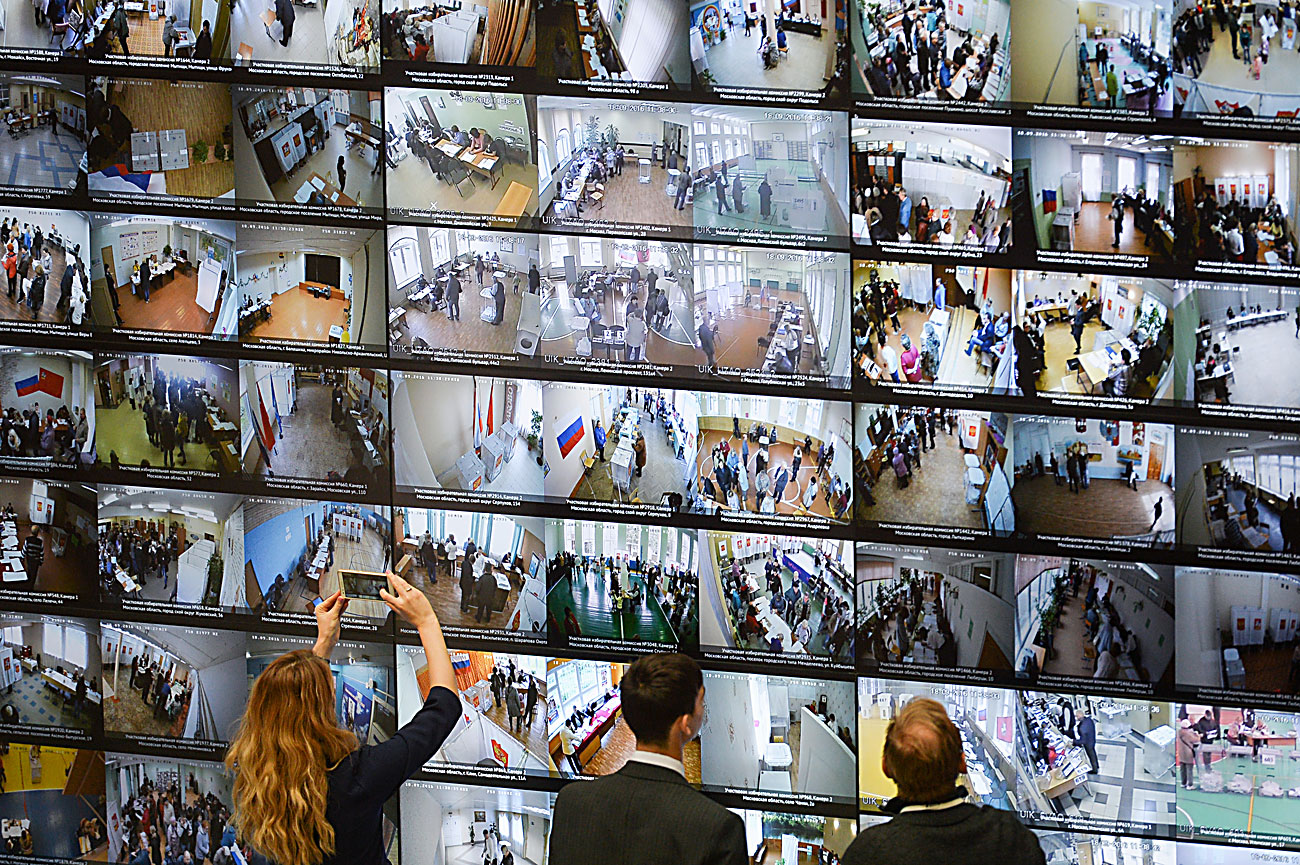 Broadcast from surveillance cameras at polling stations on the screen at the Central Electoral Commission on the general election day.