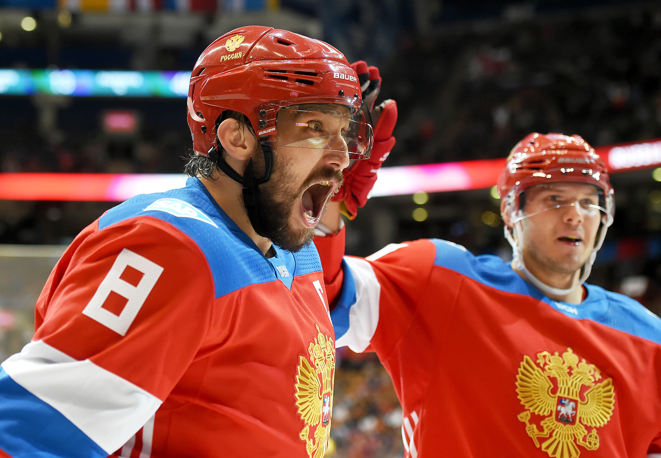 Team Russia forward Alex Ovechkin (8) celebrates with forward Evgeny Kuznetsov (92) after setting up a goal by teammate Vladimir Tarasenko (not pictured) against Team Finland during preliminary round play in the 2016 World Cup of Hockey at the Air Canada Centre in Toronto, Ontario, Canada.