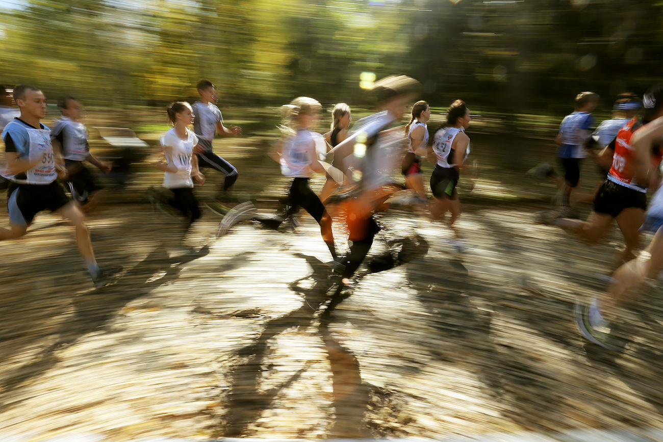 People take part in the 2016 Cross of the Nation national running event in Kurgan, Russia.