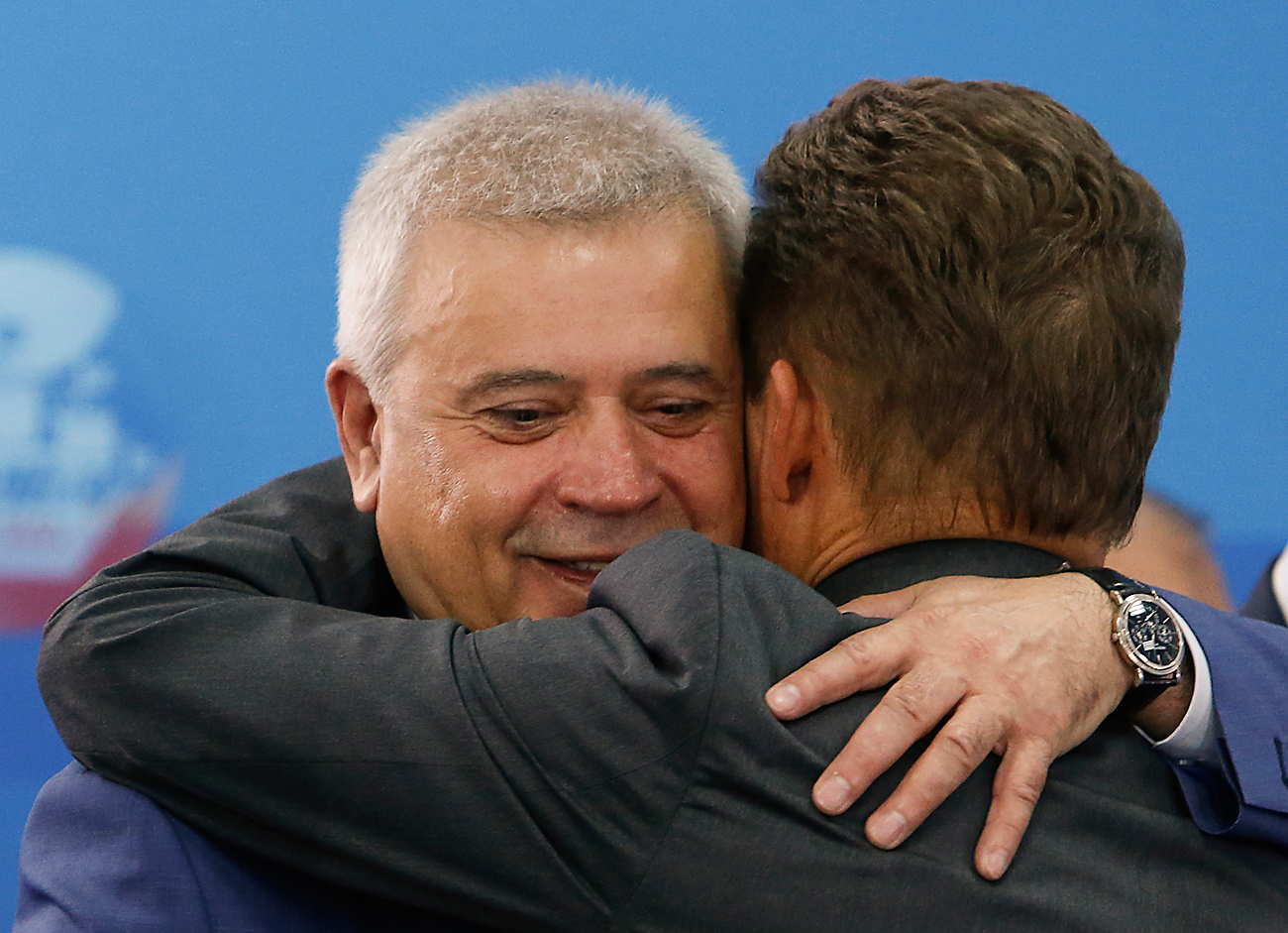 Gazprom Chief Executive Alexei Miller (right) embraces Lukoil Chief Executive Officer Vagit Alekperov during the St. Petersburg International Economic Forum 2014.