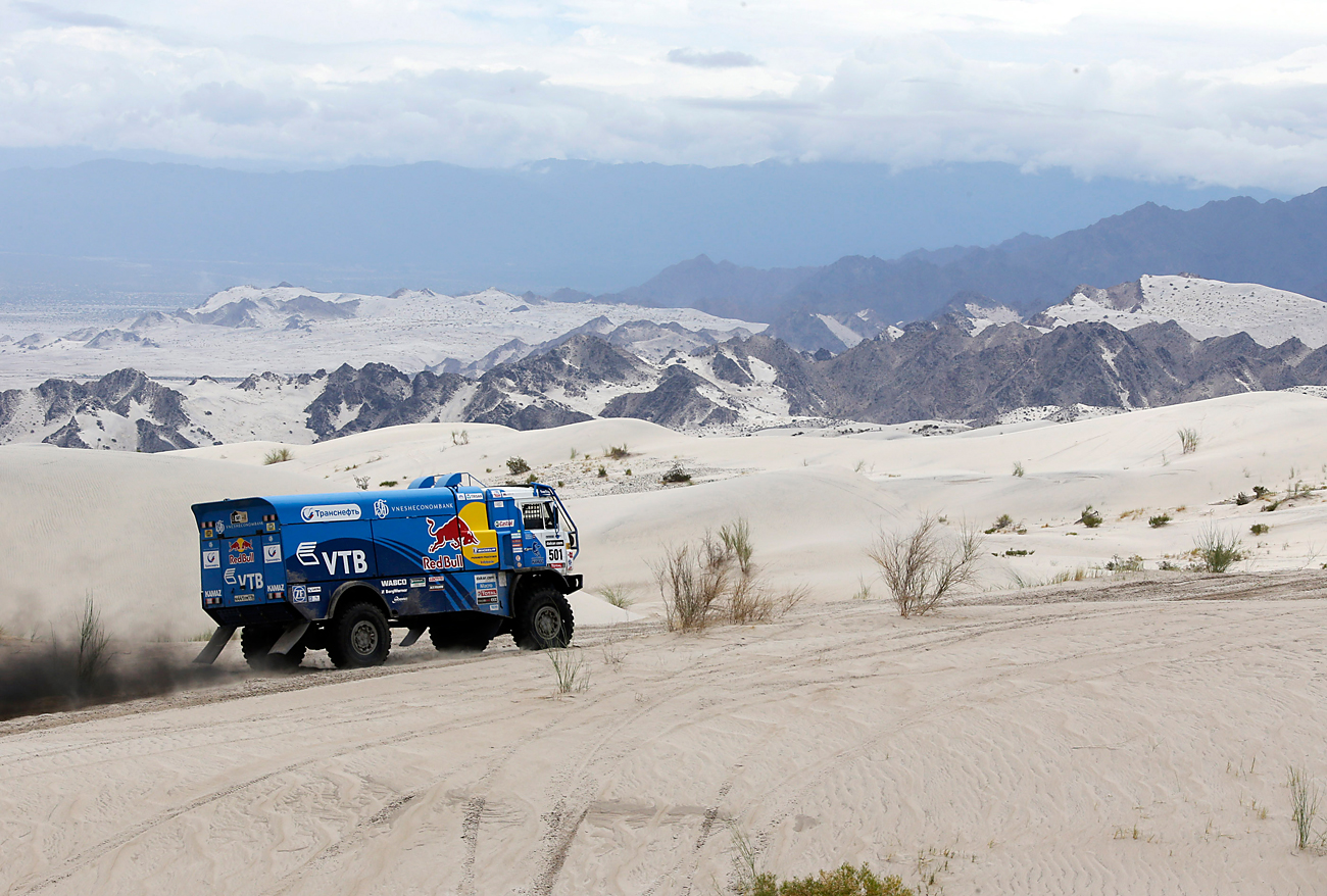 Russia's Eduard Nikolaev, co-pilots Sergey Savostin and Vladimir Rybakov compete with their Kamaz truck during the 11th stage of the Dakar Rally 2013 from La Rioja to Fiambala on Jan. 16, 2013.