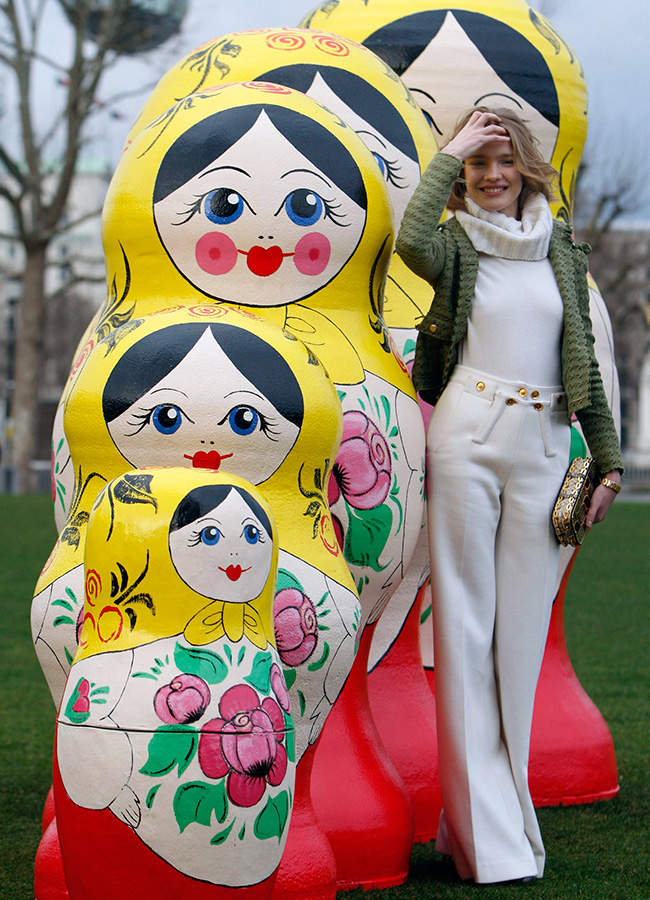 It can be any size you like — some Matryoshkas you can see from afar. / Russian model Natalia Vodianova poses with Russian dolls at the Russian Winter Festival in London, 2008.