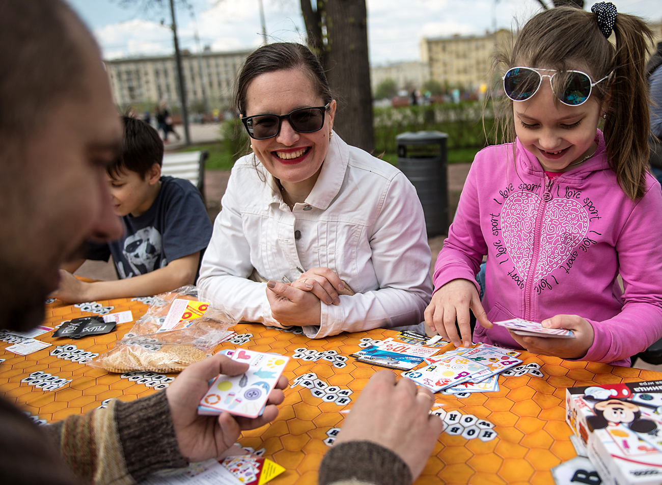 Muscovites play board games at the Central Gorky Park, Moscow.