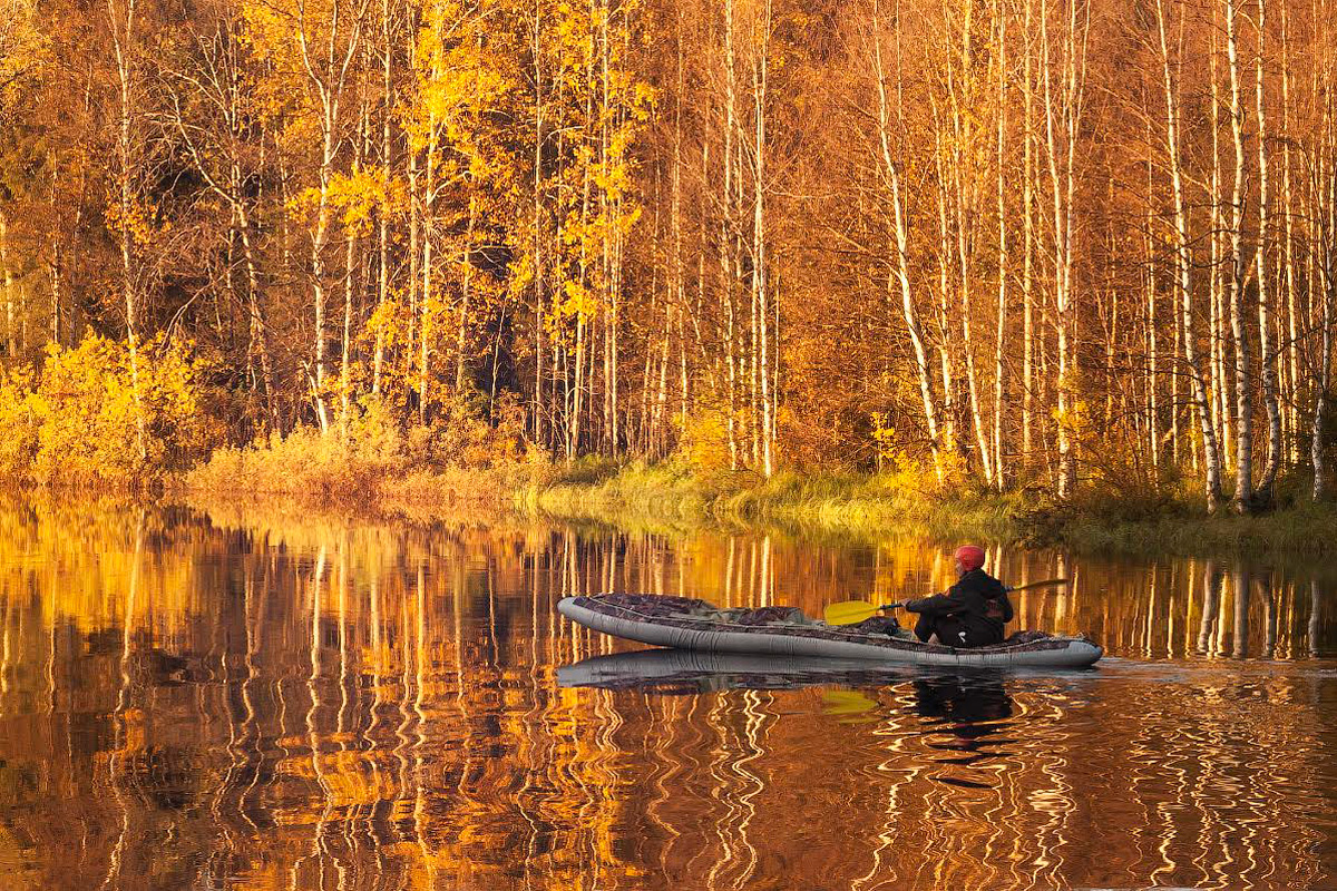 Rafting in Karelian river in fall.