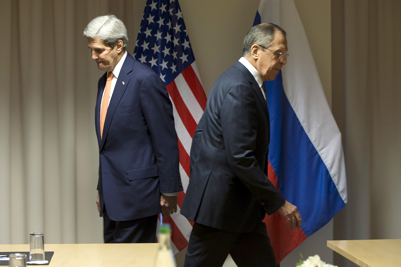 U.S. Secretary of State John Kerry and Russian Foreign Minister Sergey Lavrov walk to their seats for a meeting about Syria, in Zurich, Switzerland, Jan. 20, 2016.