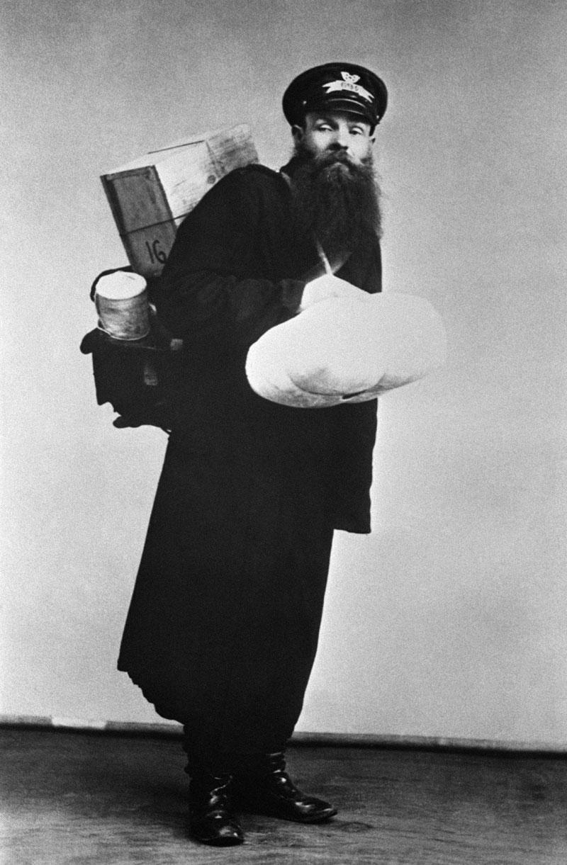 1913. A postman.