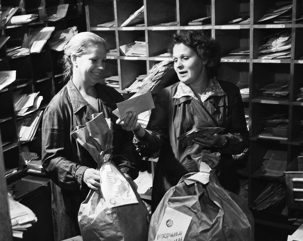 1963. Post employees sort out the mail.